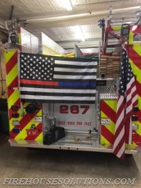 Engine 267 flying thin blue/red line flag in honor of those who have fallen in the line of duty